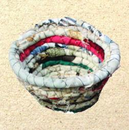 fabric basket - old clothes line wrapped in fabric and sewed in a circle